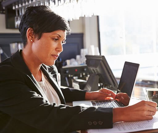 business woman in office on laptop