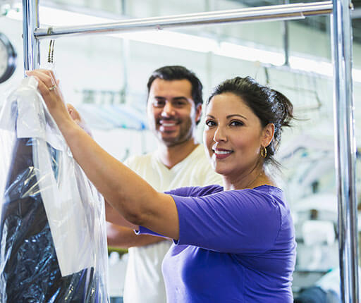 dry cleaning business owner couple