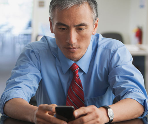 Man studying cell phone