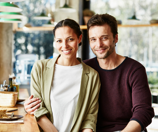 Portrait of loving business couple in restaurant