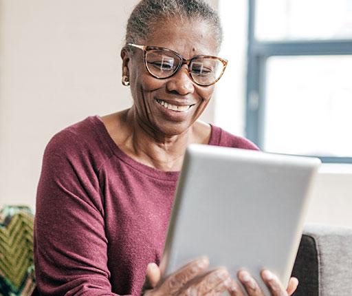 Happy elderly woman using mobile banking