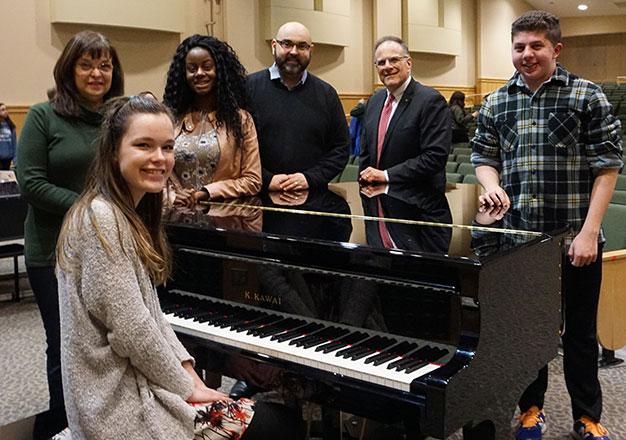 Students, staff and Bank of Canton representative at new piano