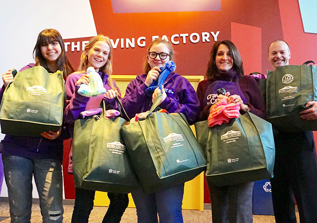 Cradles to Crayons staff receiving donation