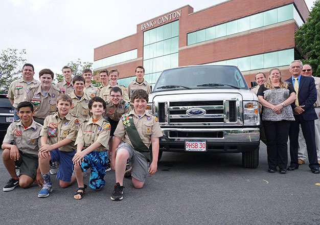 Scout troop with van at Bank of Canton headquarters