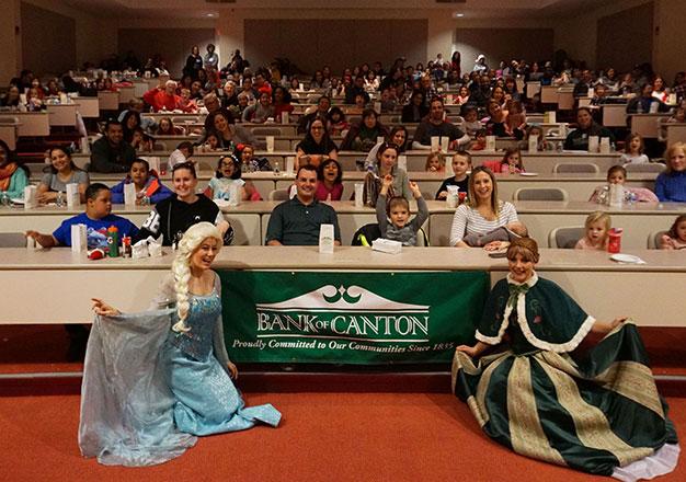 Audience for movie matinee plus princesses