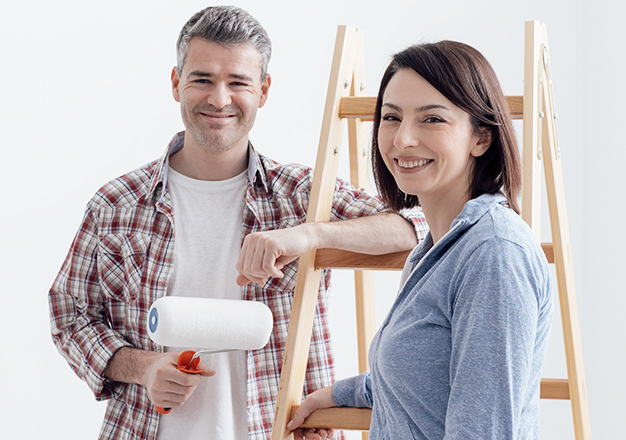 Happy couple making home improvements