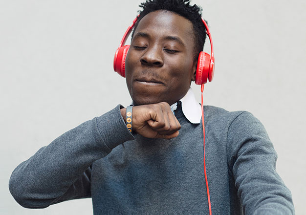 Happy young man with red headphones