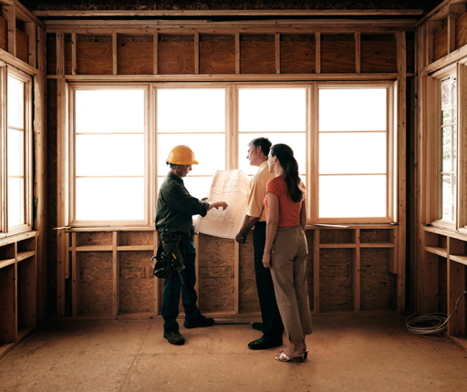 couple reviewing plans with builder